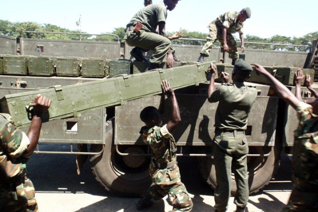 Burundian Defense Forces soldiers hand load materiel during a deployment capability assessment at Bujumbura Military Airfield, Burundi,  Dec. 15, 2010.
