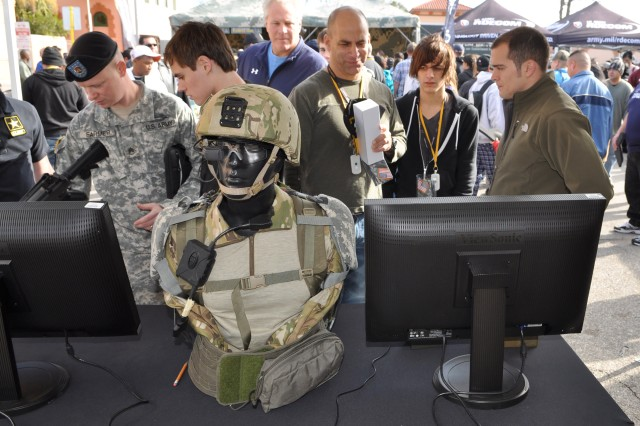 """Spectators view the latest technology in the RDECOM display at the U.S. Army All-American Bowl in San Antonio, TX. (AMC Photo by Chris Putman)"""""""