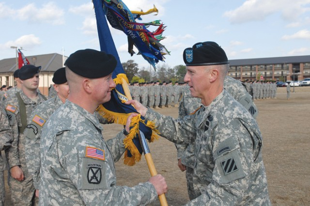 Col. Pete Jones, right, 3rd Heavy Brigade Combat Team commander, passes the battalion colors Thursday to Lt. Col. Nelson Kraft, the incoming commander for 1st Battalion, 15th Infantry Regiment.