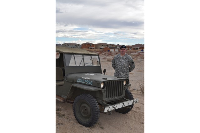Lt. Col. Stephen Thrasher, Fort Irwin and National Training Center G-3 chief of operations, stands beside his World War II jeep, a 1942 Ford GPW.
