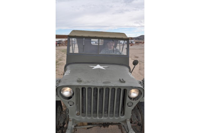 Lt. Col. Stephen Thrasher, Fort Irwin and National Training Center G-3 chief of operations, sits behind the wheel of his World War II jeep, a 1942 Ford GPW.