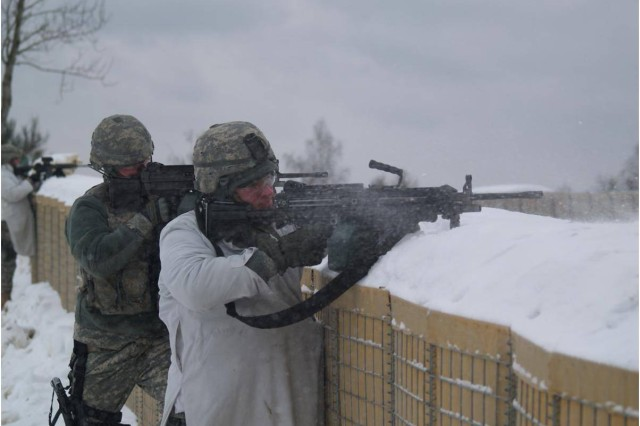 Soldiers of the 709th Military Police Battalion stand guard during a combat outpost live-fire training exercise on Range 201 on the Grafenwoehr Training Area.  The range differs from other ranges because it provides units a 360 degree fires capability.