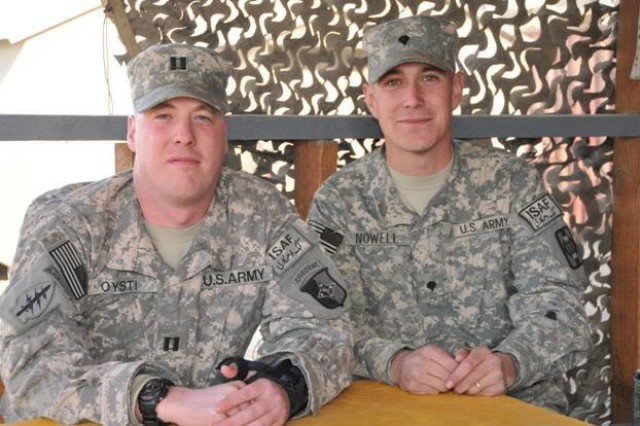Cousins Captain Timothy Oysti and Specialist Daniel Nowell of 101st Sustainment Brigade, 101st Airborne Division sit side by side for the first time in eight years while serving their country during Operation Enduring Freedom. Oysti and Nowell are the first U.S. Army soldiers in their family.