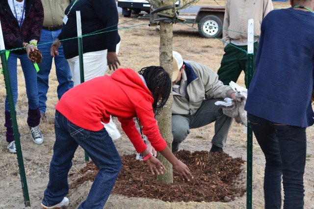 For the sake of tree posterity, employees of the Fort Stewart-Hunter Army Airfield Directorate of Public Works plant a tree at the Hunter Army Airfield School Age Youth Services, building 8805. By proclamation of Stewart-Hunter garrison commander, Col. Kevin Milton, Dec. 16 is Stewart-Hunter Arbor Day for 2010.