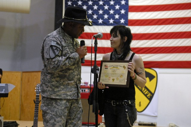 CONTINGENCY OPERATING SITE MAREZ, Iraq - Lt. Col. Monte Rone (left), executive officer for the 4th Advise and Assist Brigade, 1st Cavalry Division, thanks Joan Jett and gives her a certificate of appreciation for performing for the troops at COS Marez during a United Services Organization-sponsored concert Jan. 10.