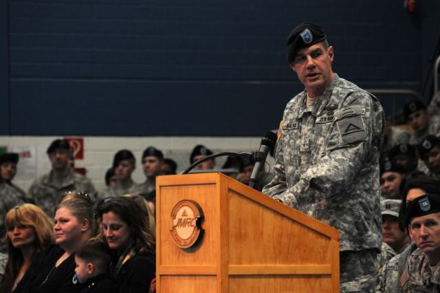 """U.S. Army Joint Multinational Training Center Commander Brig. Gen. Steven Salazar gives a speech during 1st Battalion, 4th Infantry Regiment's """"Completion of Mission"""" ceremony in the Post Gym at U.S. Army Garrison Hohenfels, Germany, Jan."""