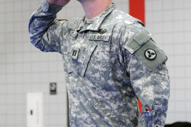 Capt. Brian W. Pilch, a native of Seward, Alaska, salutes during the Headquarters and Headquarters Company, 3d Sustainment Command (Expeditionary) change of command ceremony here at Natcher Physical Fitness Center on Jan. 13.  During the ceremony, Capt. Sarah N. Holley, a native of Elizabethtown, Ky., assumed command of HHC 3d ESC from Capt. Pilch, commander since May 2009. (U.S. Army photo by Sgt. Michael Behlin)