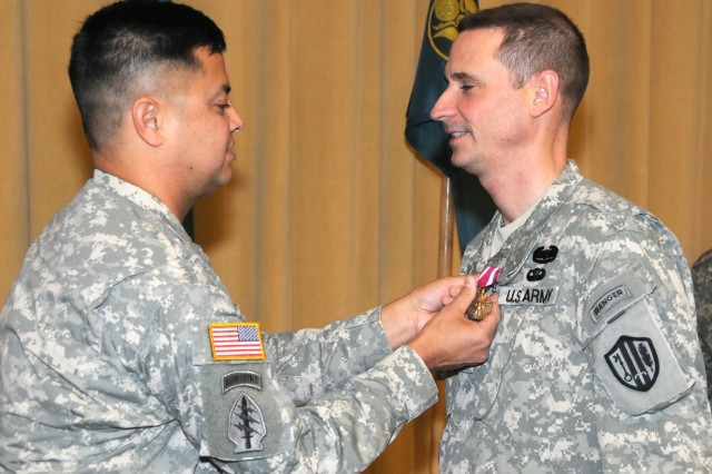 Col. John M. Diaz, commander, United States Army Reserve Information Operations Command, United States Army Reserve Joint and Special Troops Support Command, pins the Army's Meritorious Service Medal onto Lt. Col. Michael E. Lonigro, for outstanding performance as the commander, Southwest Information Operations Center.  Under Lt. Col Lonigro's tenure, he rapidly transitioned his Soldiers into an operational force by providing a continuum of service to the active Army and Joint organizations; the unit deployed the Army Reserve's largest Regional Computer Emergency Response Team to Operations Iraqi and Enduring Freedom, as well as an augmentation to the US Special Operations Command and the Joint Communications Support Element. The ceremony was held in the Blesse Auditorium on Fort Sam Houston, Texas on Jan. 9, 2011.
