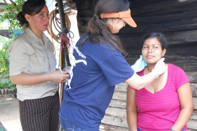 In rural Honduras, preventive medicine residents went house-to-house to examine patients for infection and take blood samples. (USAPHC (Prov) photo)