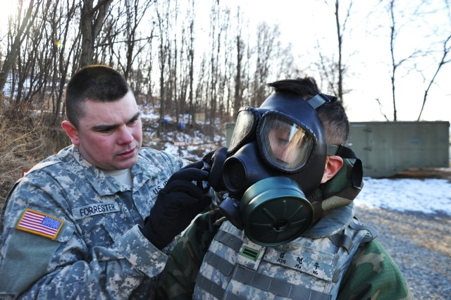 Pfc. John Forrester (left), a Chemical, Biological, Radiation and Nuclear Soldier assigned to Headquarters and Headquarters Company, 498th Combat Service Support Battalion, inspects a KATUSA Soldier's equipment at Camp Carroll, Republic of Korea. Soldiers of 498th CSSB conducted the training to test their equipment and maintain familiarity with it.