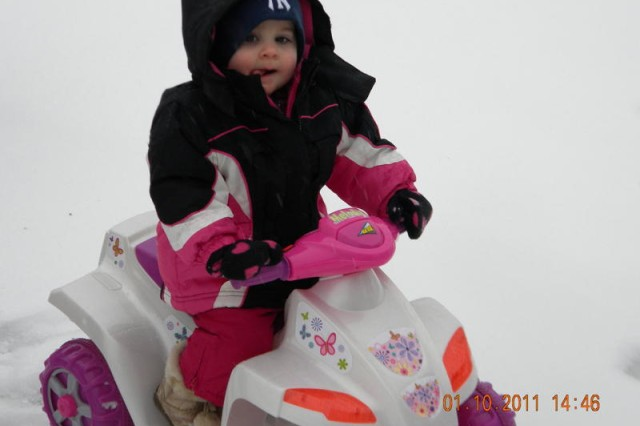 Sierra Belden, 16 months,  is all bundled up while going for a ride in the snow.