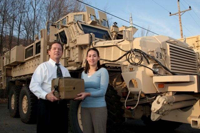 Mike Ivankoe (left) and Peggy Wilson, engineers with the Armament Research, Development and Engineering Center (ARDEC) Packaging Division, and Lt. Col. Glenn Dean (currently Project Manager for Bradley Fighting Vehicles, not pictured) were the three inventors of the Modular Ammunition Restraint System (MARS), which provides Soldiers safe and effective ammo stowage on Mine-Resistant, Ambush-Protected (MRAP) vehicles.