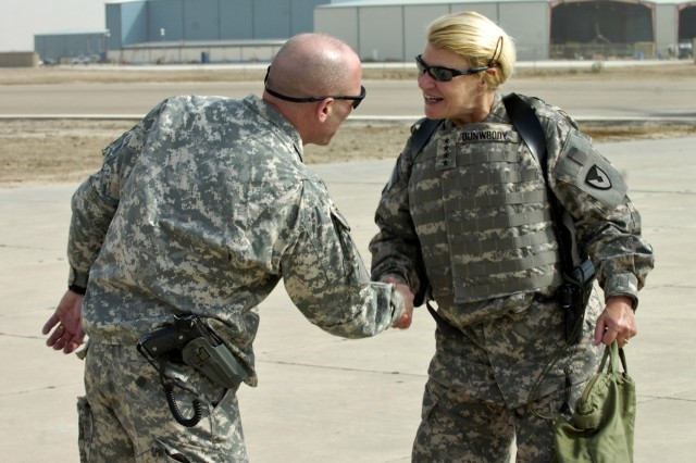Gen. Ann E. Dunwoody greets a Soldier during a visit to Iraq.