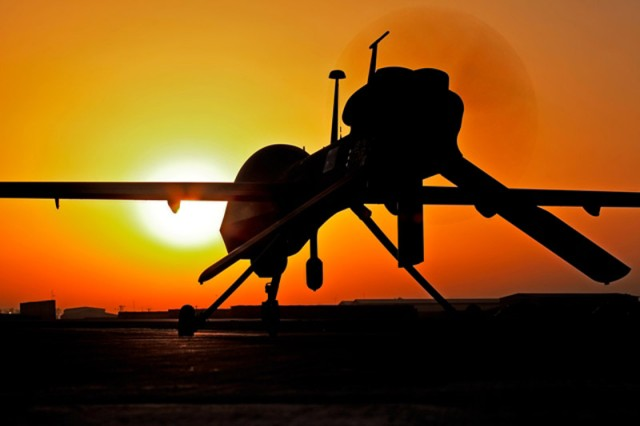 The 3,200-pound Gray Eagle Unmanned Aircraft System (UAS) waits for its mission at sunset during Operation Enduring Freedom in Afghanistan.