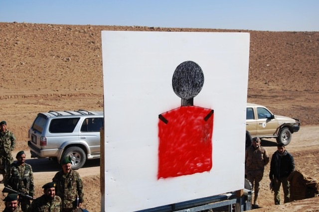 Members of the 207th Corps Afghan National Army look at a target on the new Corps training range complex at Camp Zafar, Herat.
