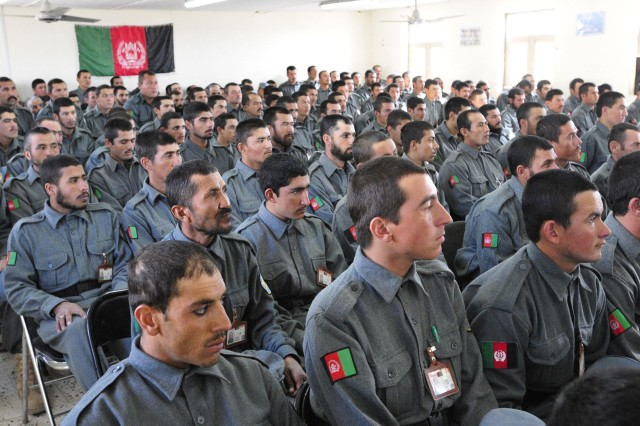 SPIN BOLDAK, Afghanistan - Afghanistan National Police attend their graduation ceremony from the basic training course at the ANP training center in Spin Boldak Jan. 5. The six-week course is taught by NATO working together with Afghan instructors to reinforce ANP fundamentals. The training includes vehicle operations, various weapons familiarization, handcuffing and hand-to-hand combat. (U.S. Army photo by Sgt. Richard Andrade / 16th Mobile Public Affairs Detachment)