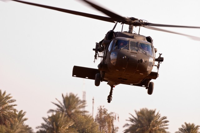 An Army Black Hawk helicopter deployed to Iraq with the Enhanced Combat Aviation Brigade, 1st Infantry Division takes off from a pad near Baghdad, Jan. 12.