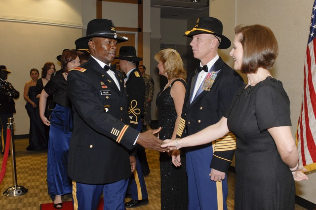 FORT HOOD, Texas - Command Sgt. Maj. Ronnie Kelley and his wife Alice greet guests of the Greywolf Gala, a military ball by 3rd Brigade Combat Team, 1st Cavalry Division, Jan. 7 at the Killeen Civic Center. The ball promoted unit cohesion and camaraderie before the unit's upcoming deployment to Iraq.