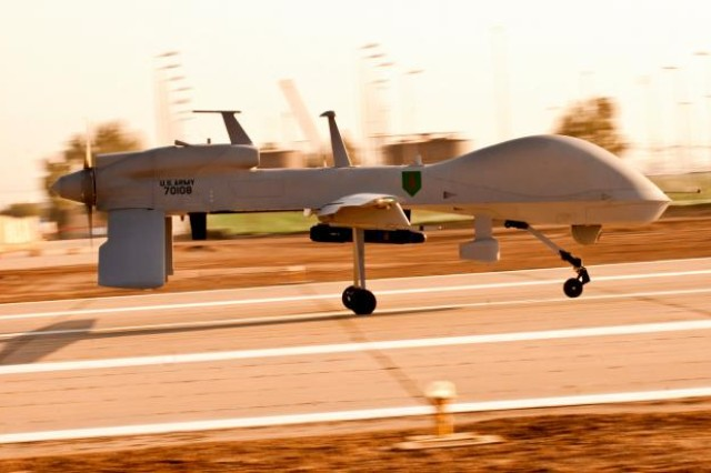 "An MQ-1C Gray Eagle unmanned aircraft makes its way down an airfield on Camp Taji, Iraq, before a surveillance mission in the Baghdad area. The Gray Eagle is the Army's newest ""eyes in the sky,"" and is being tested by Quick Reaction Capability 1-Reaction 1, the only unit using the aircraft in Iraq."