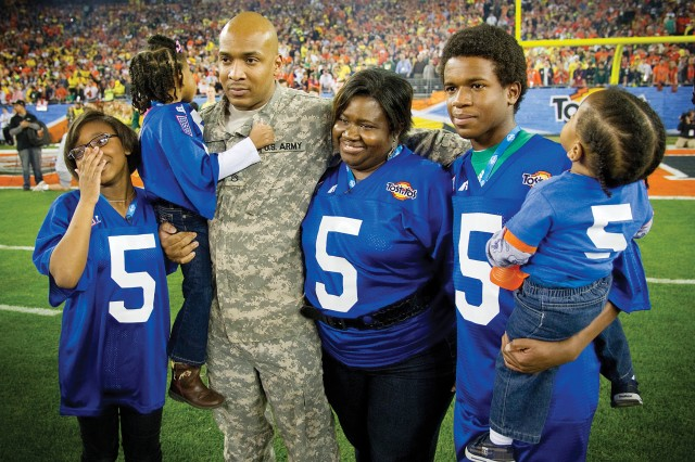 Staff Sgt. Alton Day reunites with his family Jan. 10 at the BCS championship.