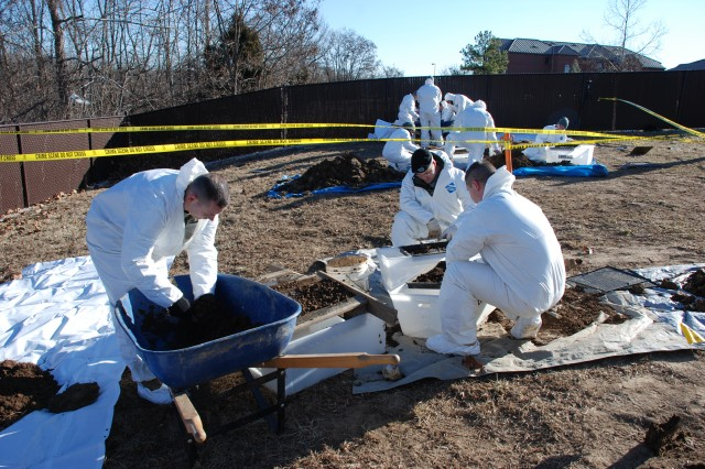 Special agents with the Major Procurement Fraud Unit, one of four specialized units within the 701st Military Police Group, U.S. Army Criminal Investigation Command, respond to a crime scene in the Washington, D.C. area.