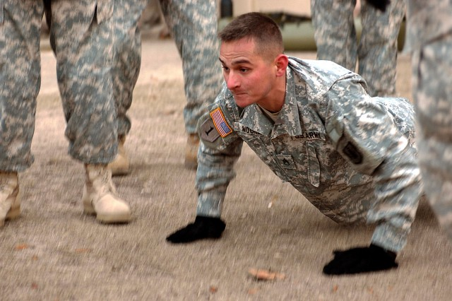 FORT HOOD, Texas - Staff Sgt. Jerry Moore, the line platoon sergeant for 324th Network Support Company, and a native of Mountainview, Ark., does push-ups during the company's monthly Phoenix Mile competition, Jan 11.