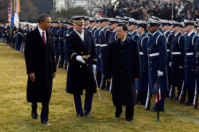 Col. David Anders, 3d U.S. Infantry Regiment (The Old Guard) Commander, leads U.S. President Barack Obama and Chinese President Hu Jintao during a pass and review of members of the U.S. Armed Forces.