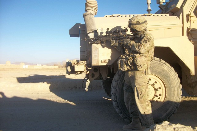 Spc. Chad Summerfield, 3rd Platoon, Company D, 1st Battalion, 168th Infantry Regiment, Task Force Lethal, returns fire on insurgents who initiated an attack on the unit and Afghan National Army soldiers Jan 9.