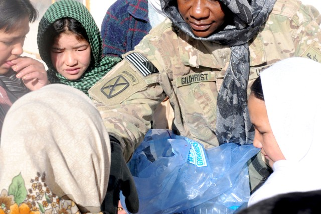 Sgt. 1st Class Luppa Gilchrist, supply noncommissioned officer assigned to 4th Brigade Combat Team, hands out candy to Afghan children at an orphanage in Bamyan.