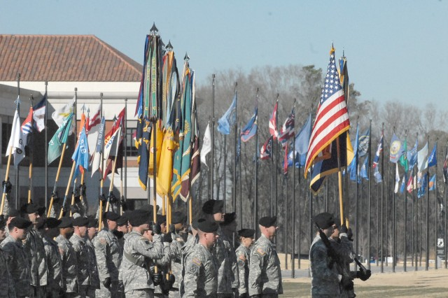 During the 3rd Heavy Brigade Combat Team, 3rd Infantry Division's change of command ceremony at the National Infantry Museum's parade field, the commanders and colors of the 3rd HBCT stand at attention, Jan. 13.