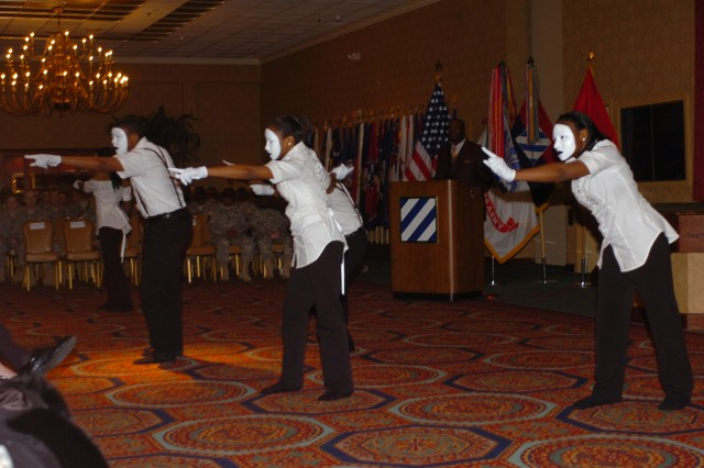 The Mount Zion Memorial Chapel Inspirational Dance Group performs at the 2011 Dr. Martin Luther King, Jr. Observance, presented by the Third Infantry Division, Jan. 12, at Club Stewart.