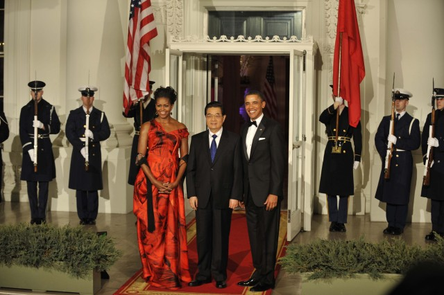 President Barack Obama and First Lady Michelle Obama stand with Pesident Hu Jintao at the North Portico of the White House prior to the State Dinner for China, Jan. 19, 2011.