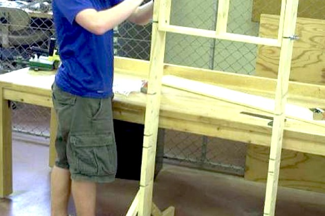 Boy Scout Drew Parker works on the framework for new air rifle targets for the Rheinblick shooting range as part of his Eagle Scout project.