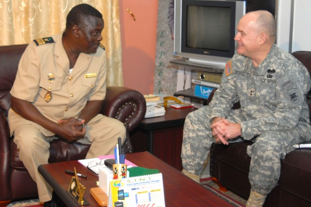Maj. Gen. David R. Hogg, commanding general, U.S. Army Africa, talks with Togolese Col. Wiyao Balli, army chief of staff, during a meeting in Lome, Togo, Jan. 12. The two met to discuss the future of U.S. Army and Togolese Army partnership. This was Hogg's first visit to Togo.