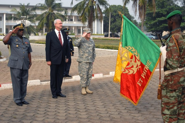 Maj. Gen. Mathieu Amoussa Chabi Boni (left to right), Beninese army chief, U.S. Ambassador James Knight, and Maj. Gen. David R. Hogg, commanding general, U.S. Army Africa, salute Beninese military forces at the military headquarters in Contonou, Benin, Jan. 13. Hogg met with senior military leaders in Benin to discuss future partnership opportunities between the two countries.