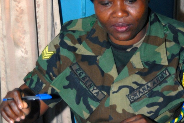 Ghanaian Army Sgt. Justine Esbenya concentrates on a practical exercise during a week-long Basic Security Management Class, Jan. 11, in Accra, Ghana. The 27-student class, taught by U.S. Army Africa personnel, is learning about information security, industrial security, personnel security and  physical security. This is the first security class taught by USARAF in Ghana.