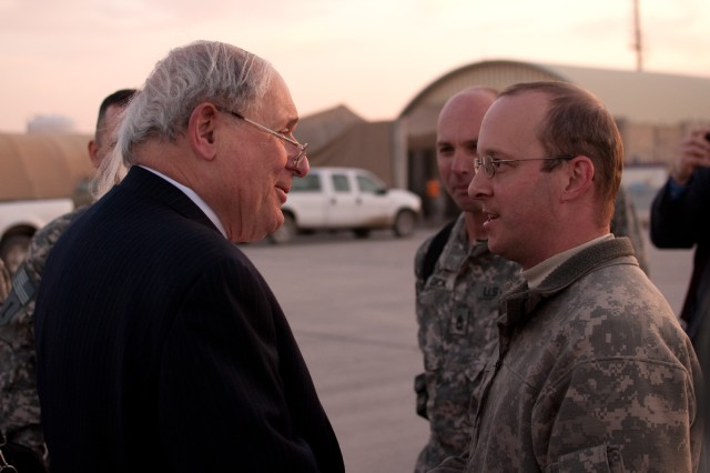 Sen. Carl Levin speaks with Staff Sgt. David Argo, a Black Hawk helicopter crew chief with the Michigan National Guard's B Company, 1st Assault Helicopter Battalion, 147th Aviation Regiment during a trip to Iraq, Jan. 19. Argo and fellow crew members flew Levin and two other congressmen to Baghdad International Airport, where they shut down for a few moments to talk with the senator before he continued his trip. (U.S. Army photo by Spc. Roland Hale, eCAB, 1st Inf. Div. PAO)