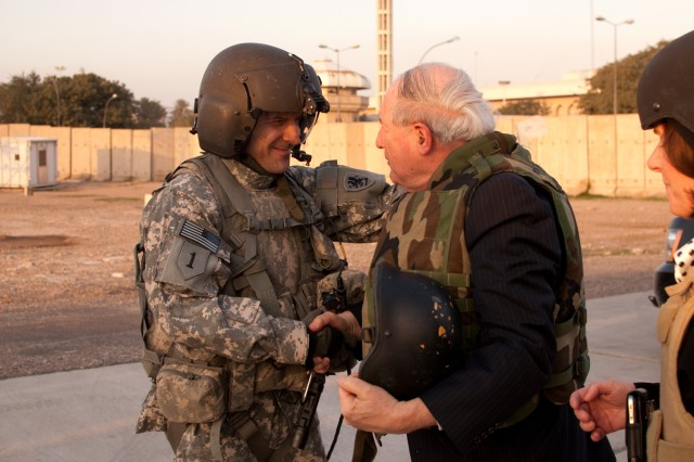 Sen. Carl Levin speaks with Sgt. 1st Class Ari Golden, a Black Hawk helicopter crew chief with the Michigan National Guard's B Company, 1st Assault Helicopter Battalion, 147th Aviation Regiment during a trip to Iraq, Jan. 19. Argo and fellow crew members flew Levin and two other congressmen to Baghdad International Airport, where they shut down for a few moments to talk with the senator before he continued his trip. (U.S. Army photo by Spc. Roland Hale, eCAB, 1st Inf. Div. PAO)
