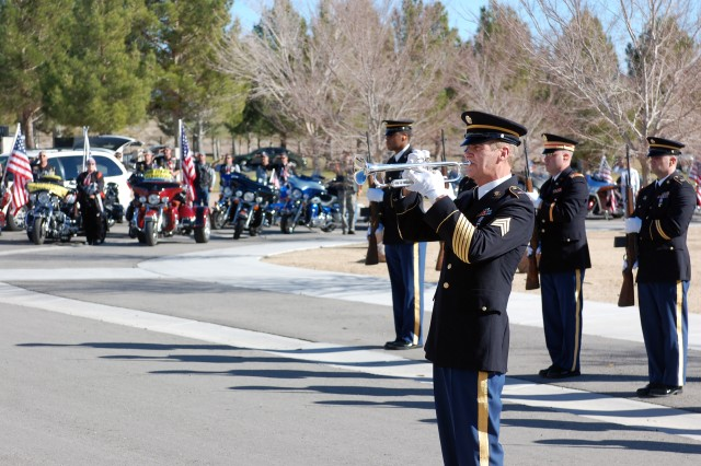 """A bugler plays """"Taps"""" as members of the 1st Squadron, 221st Cavalry, Nevada Army National Guard, rifle squad and the Patriot Guard render honors to Spc. Ronald Gaines in Las Vegas, Jan. 18. Gaines was killed in a hit and run accident on Jan. 8. (Photo by Spc. Zachary A. Gardner, 11th ACR Public Affairs)"""