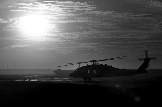 A 101st Combat Aviation Brigade, 101st Airborne Division (Air Assault) UH-60 Black Hawk helicopter taxies off the flight line during sunset on Kandahar Airfield, Afghanistan after completing a mission. The 101st CAB is based out of Fort Campbell, Kentucky. (U.S. Army photo by Spc. Edward A. Garibay, 16th Mobile Public Affairs Detachment)