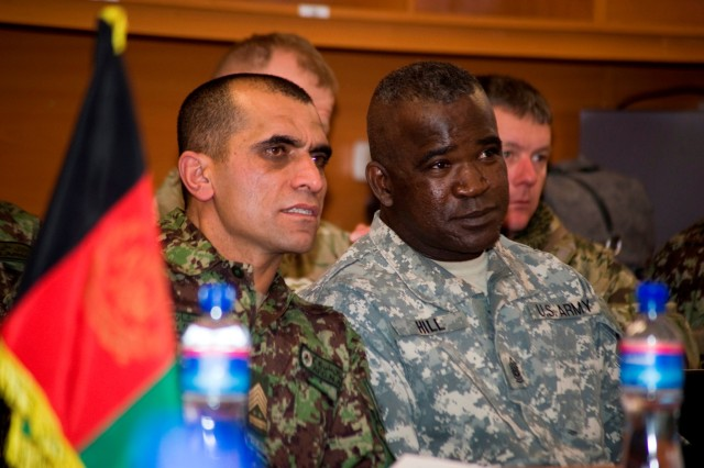 KABUL, Afghanistan (Jan. 18, 2011) - Afghan Sgt. Maj. of the Army Roshan Safi talks to Cmd. Sgt. Maj. Marvin Hill, Command Senior Enlisted Leader for International Security Assistance Force, during a ceremony in Safi's honor at Kabul Military Training Center Jan. 18, 2011. Safi was inducted into the United States Army Sergeants Major Academy International Hall Of Fame.