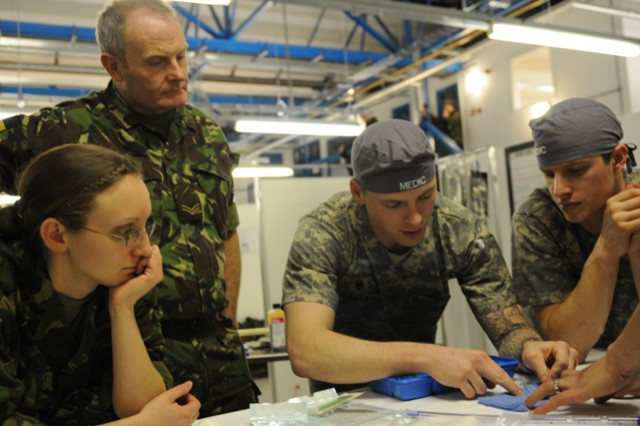 Spc. David Tucker, a medic with the 67th Forward Surgical Team (Airborne), demonstrates suture techniques for medical Soldiers from the 67th FST (ABN) and the 208th Field Hospital (Liverpool), during Operation Starlight II in Strensall, England, Jan. 22.