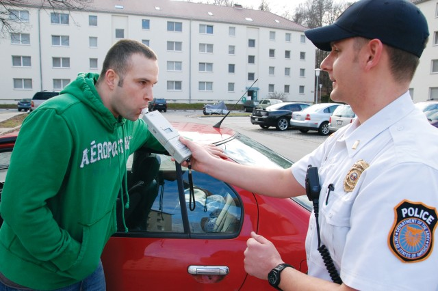 Lt. John Cable (right), a traffic accident investigator for the Department of the Army Civilian Police, issues a breathalyzer test to a Soldier stationed in U.S. Army Garrison Stuttgart. In Germany, the legal a blood-alcohol content limit is 0.05.