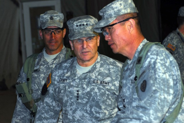 Gen. George W. Casey Jr., chief of staff of the Army, visits 3rd Brigade Combat Team, 25th Infantry Division commander, Col. Richard Kim (right) and Command Sgt. Maj. Andrew Spano (left) at the National Training Center, Fort Irwin, Calif., Jan. 22. The 3rd BCT, 25th Inf. Div., stationed out of Hawaii, is training and preparing for a yearlong deployment to Afghanistan.