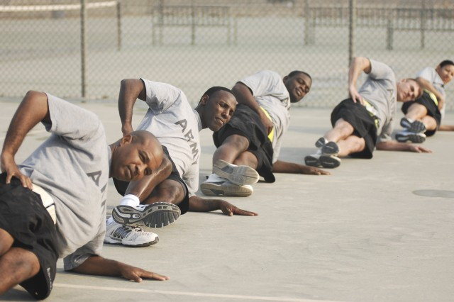 Third Army Soldiers conduct a session of the new Army Physical Readiness Training program at Camp Arifjan, Kuwait, Jan. 13. Third Army is implementing the plan to both limit injuries and increase readiness.