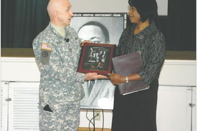 Guest speaker Judge Angela Eaves, who serves on the Circuit Court for Harford County, Md., receives a token of appreciation from Maj. Gen. Nick Justice, APG commander during the MLK event Jan. 12.
