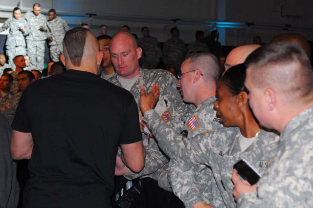 Chuck Liddell, one of UFC's more well-known competitors, circulated through the crowd of servicemembers, signing autographs and posing for photos at West Fort Hood, Texas Jan. 22, 2011, at UFC's Fight for the Troops. Fight for the Troops is raising awareness for UFC Intrepid Fallen Heroes Fund, which is a leading effort in supporting servicemembers who suffer from Traumatic Brain Injuries sustained from overseas tours.
