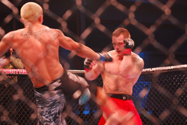 Waylon Lowe guards himself after opponent Williamy Freire attempts a kick during the UFC Fight for the Troops, Jan. 22, 2011, at West Fort Hood, Texas. Fight for the Troops is raising awareness for UFC Intrepid Fallen Heroes Fund, which is a leading effort in supporting servicemembers who suffer from Traumatic Brain Injuries sustained from overseas tours.