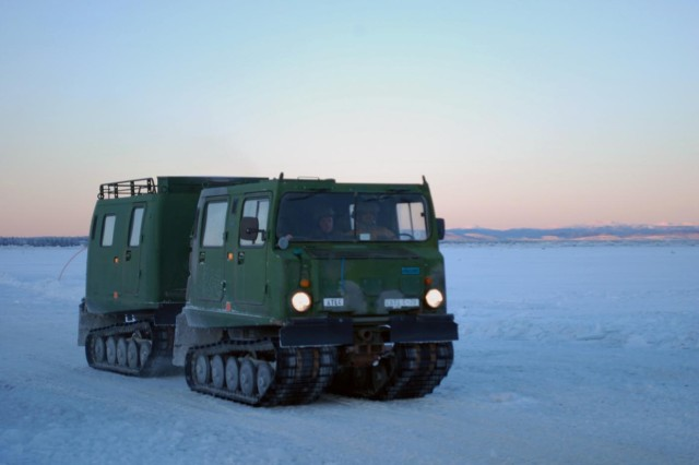 U.S. Army troops driving a Small Unit Support Vehicle across the ice bridge road at the Cold Regions Test Center at Fort Greely Jan. 12.