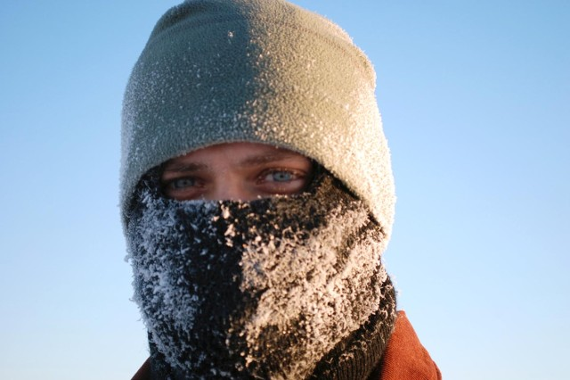 Frost forms on Pfc. Jason N. WoolardAca,!a,,cs balaclava during the minus 24 degree workday Jan. 12 at Fort Greely, Alaska. Woolard is a medic with Headquarters and Headquarters Company, 6th Engineer Battalion.